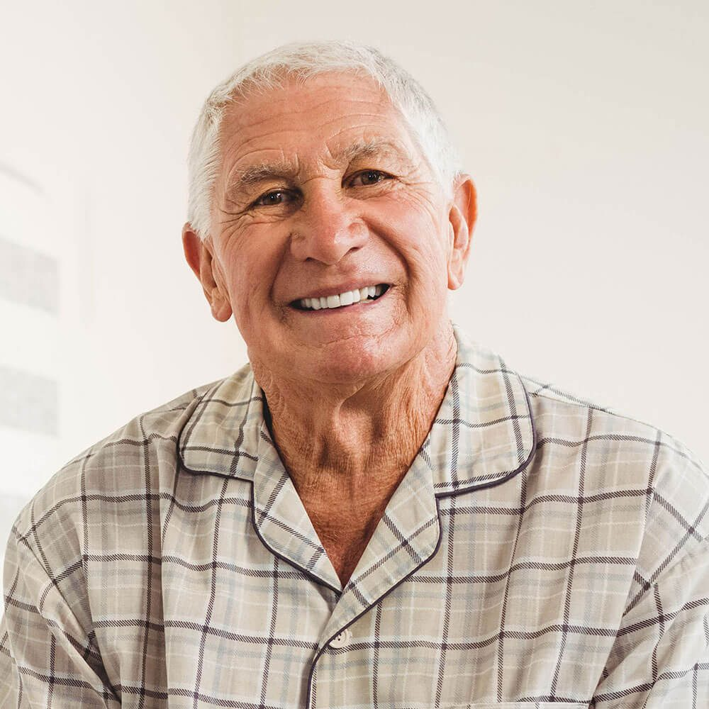 Smiling older caucasian male with white hair